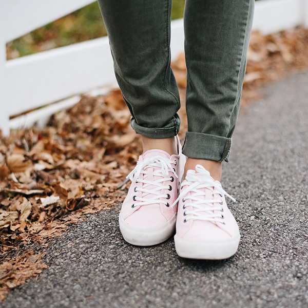 army green jeans, pink sneakers