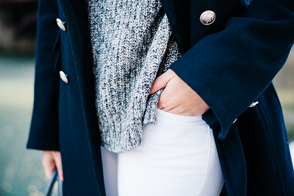 navy blue coat, grey sweater, white jeans