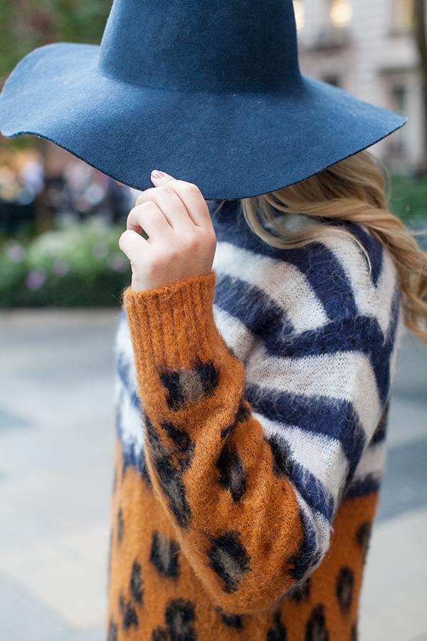 navy blue floppy hat, sandro orange blue striped leopard animal print sweater