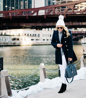 Bows & Sequins wearing a winter outfit with white jeans in Chicago.
