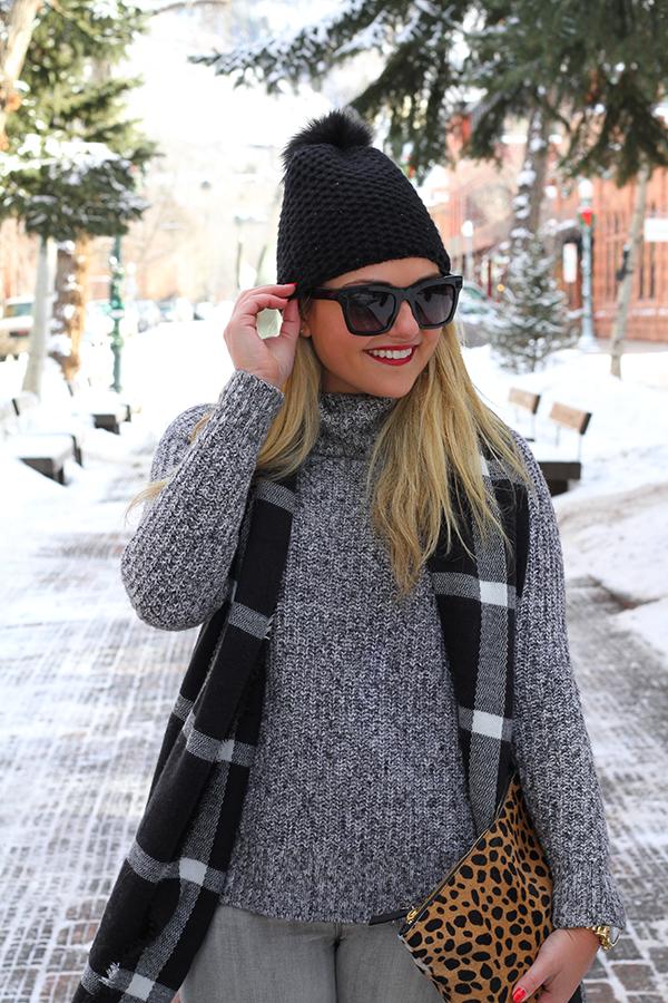 black beanie fur pom grey turtleneck sweater valentino sunglasses plaid blanket scarf
