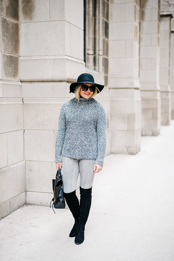 black over the knee boots with grey jeans