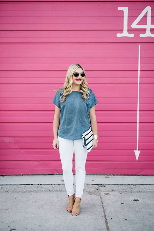 Bows & Sequins wearing a chambray shirt, white jeans, nude heels, and a striped clutch