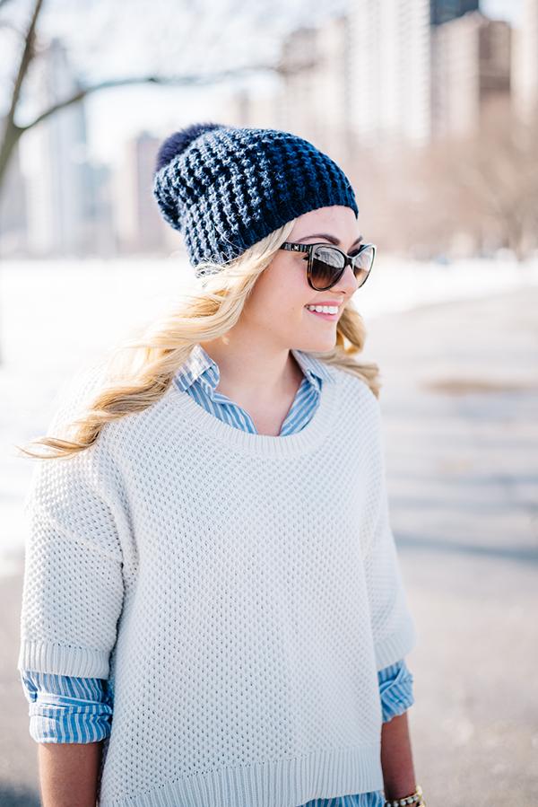 layer a sweater over an oxford shirt