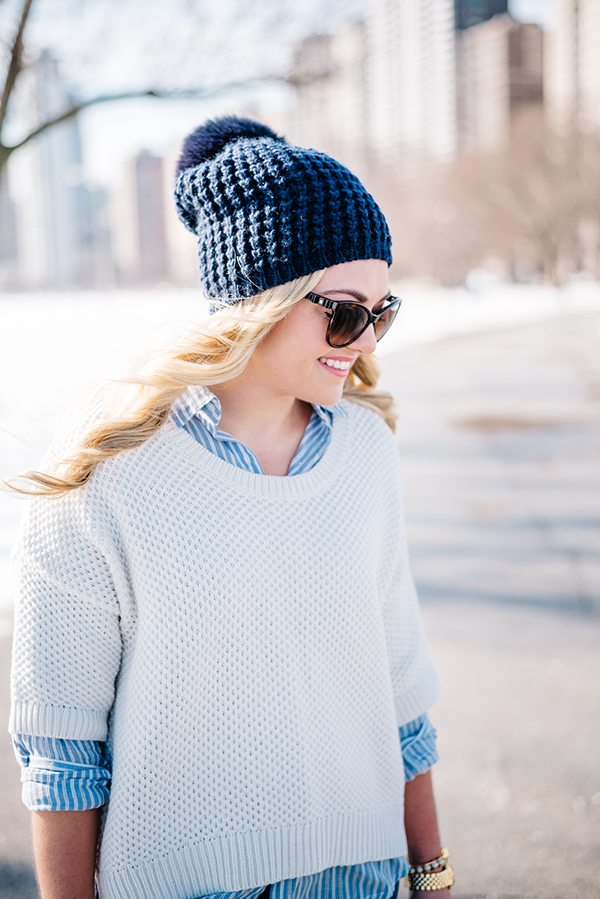 navy blue pom beanie, textured pullover sweater, striped boyfriend oxford shirt, chanel sunglasses