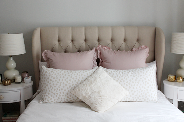 white blush pink bedding animal sham tufted linen wingback headboard