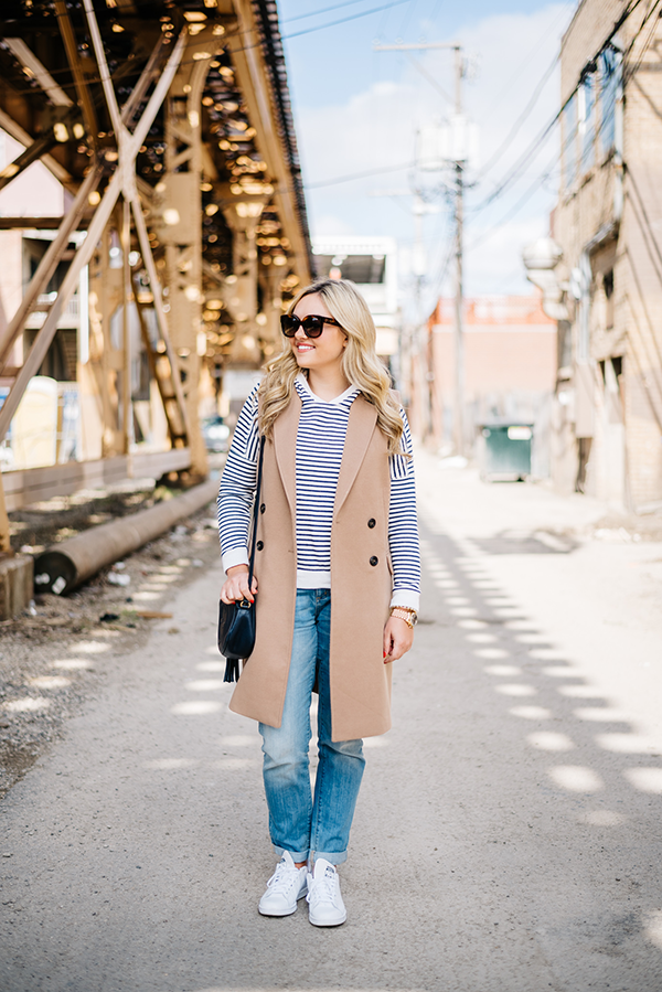 navy blue striped shirt, long camel vest, vineyard vines boyfriend jeans, gucci disco soho bag, adidas stan smith white with blue sneakers women