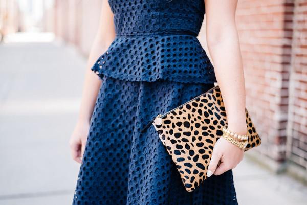 banana republic navy eyelet peplum dress, clare vivier leopard calf hair clutch