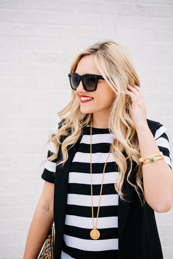 black and white striped top with black vest