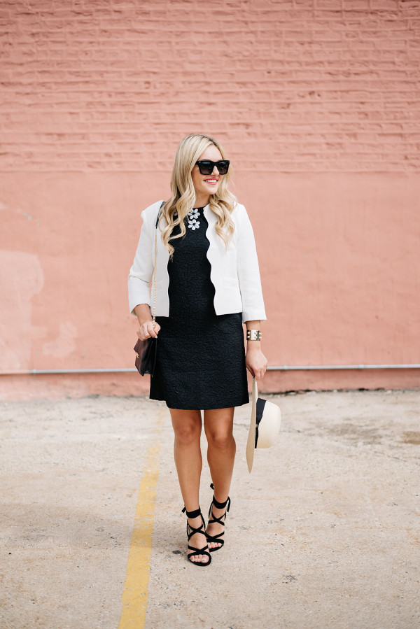 black dress with a white blazer and black lace-up heels