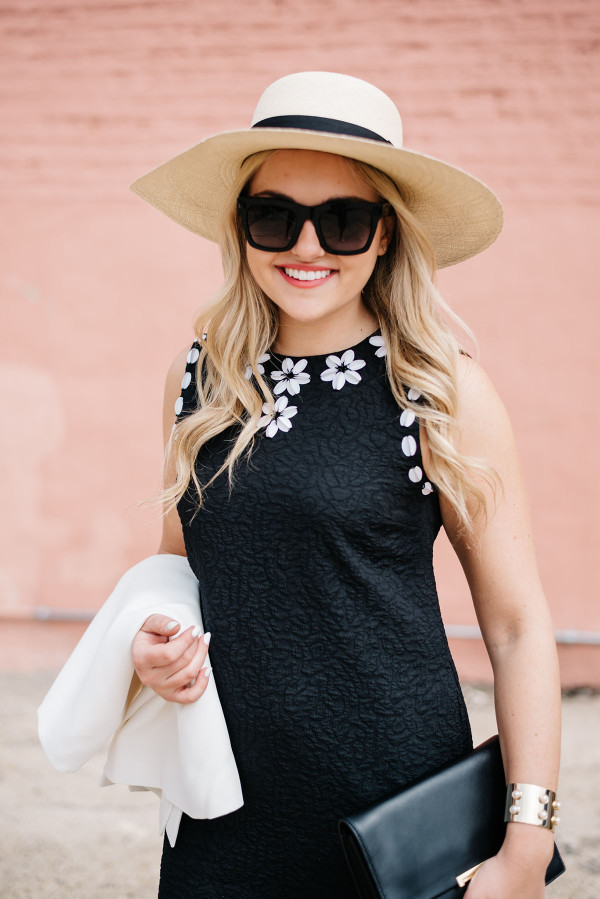 black dress with white flowers, white jacket, summer straw hat wide brim