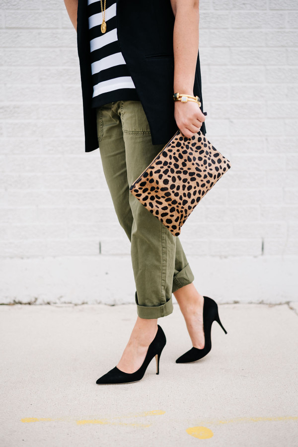 black pointed toe suede pumps, army green chino pants, leopard clutch