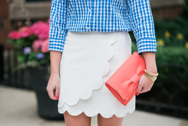 blue gingham shirt, white scalloped skirt, coral bow clutch outfit for spring