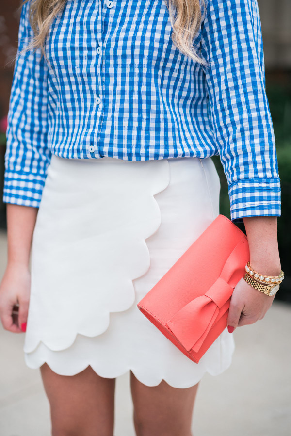 blue gingham shirt, white scalloped skirt, coral bow clutch spring outfit ideas