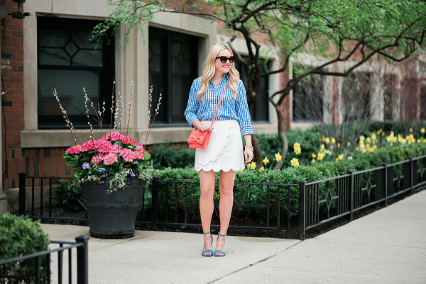 colorful spring outfit gingham shirt white skirt blue heels coral crossbody bag