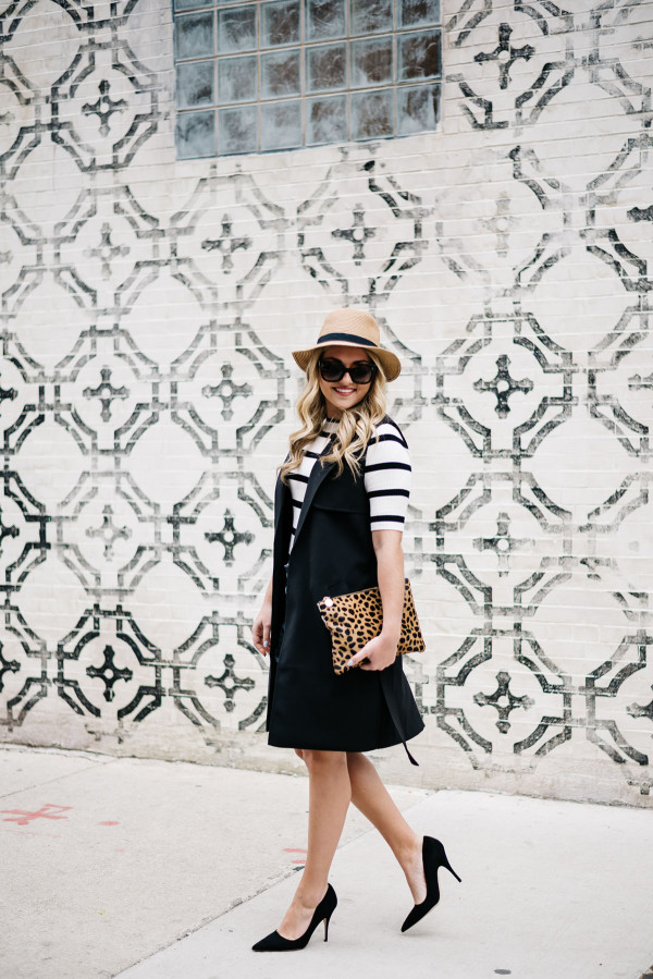 how to wear a long black vest in the summer leopard clutch panama hat