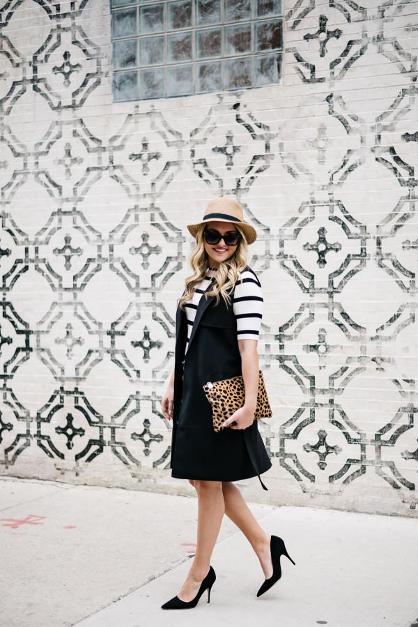 how to wear a long black vest in the summer leopard clutch panama hat