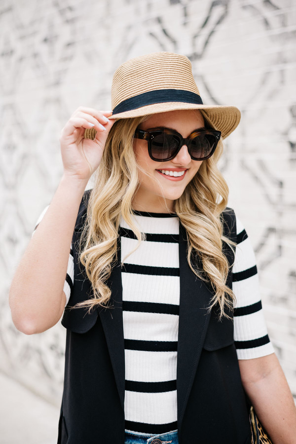 j.crew panama hat, celine sunglasses, black and white striped elbow length tee shirt, black vest