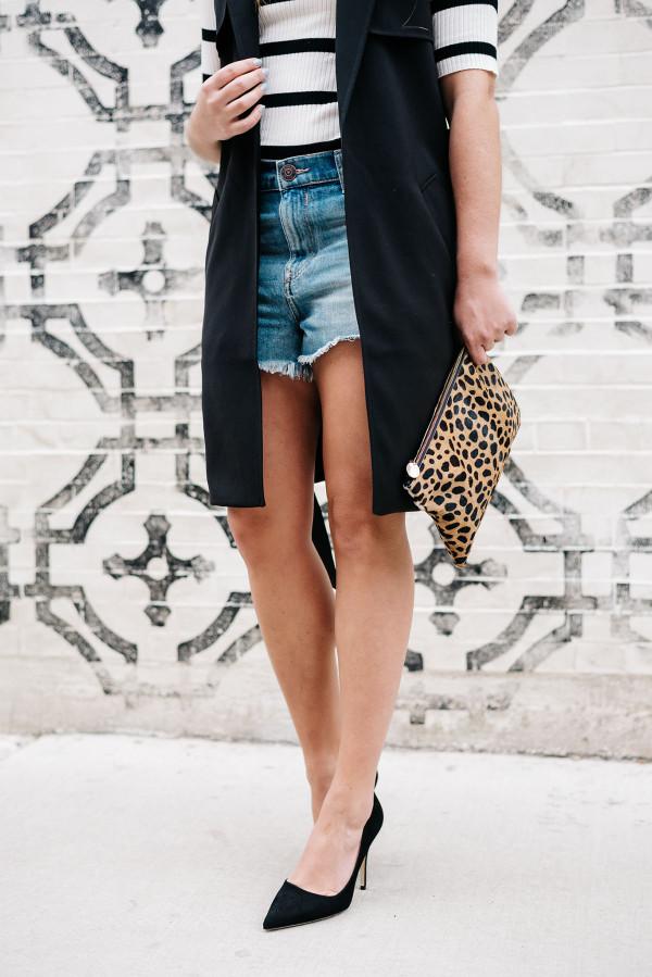 high waisted denim cutoff shorts, long black vest, clare v leopard calf hair clutch, black kate spade licorice pumps