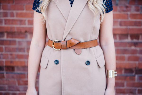 leather belt over a vest