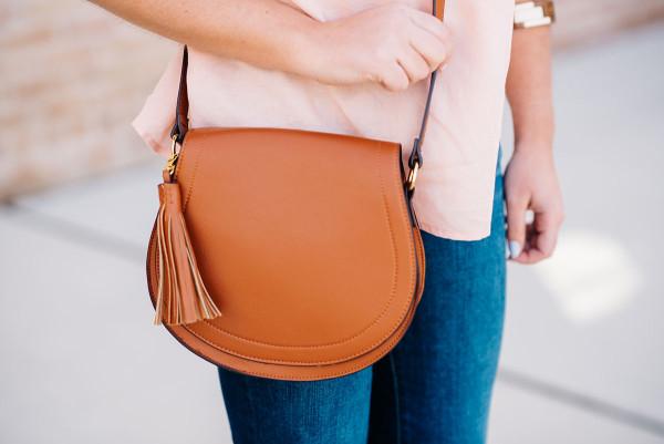 leather saddle bag with tassel