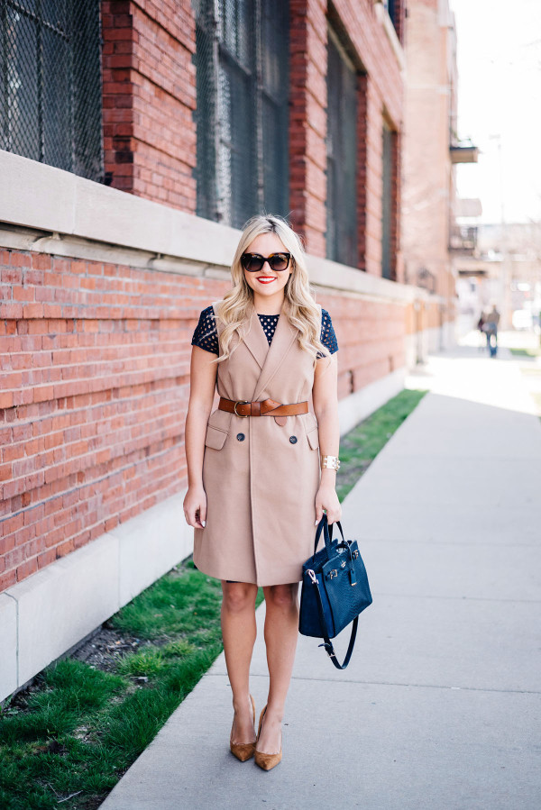 long camel vest over a navy dress work outfit