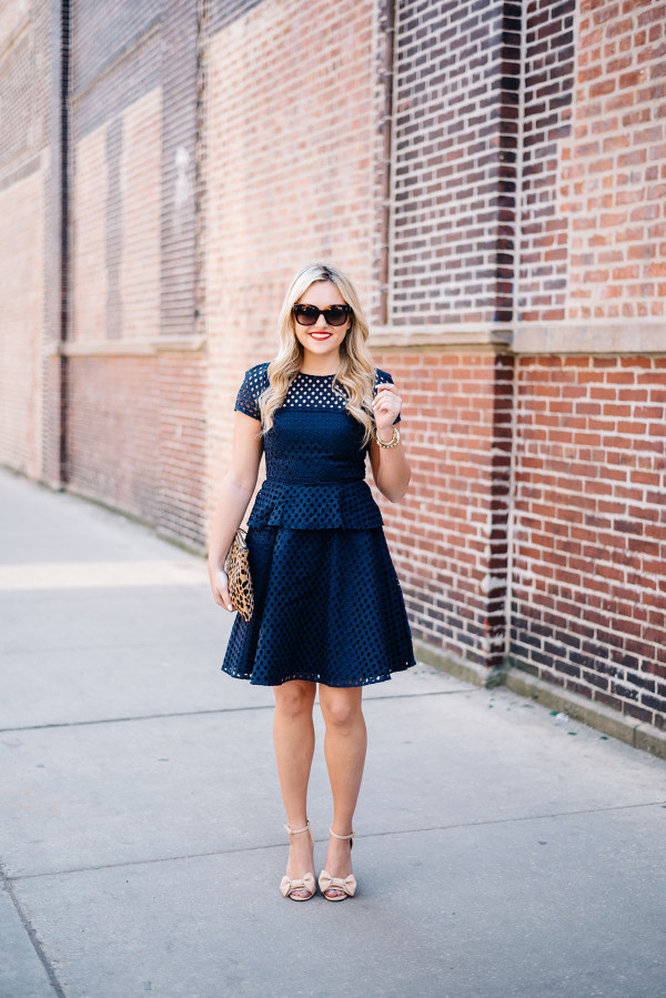 navy dress with leopard clutch and bow sandals
