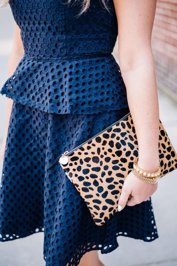 navy peplum dress, leopard calf hair clutch