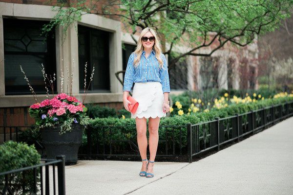 outfit for spring blue gingham shirt, white scalloped skirt, coral bow clutch