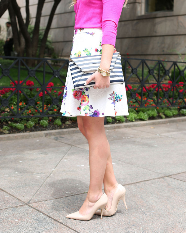 pink sweater, floral skirt, striped clutch, nude pumps