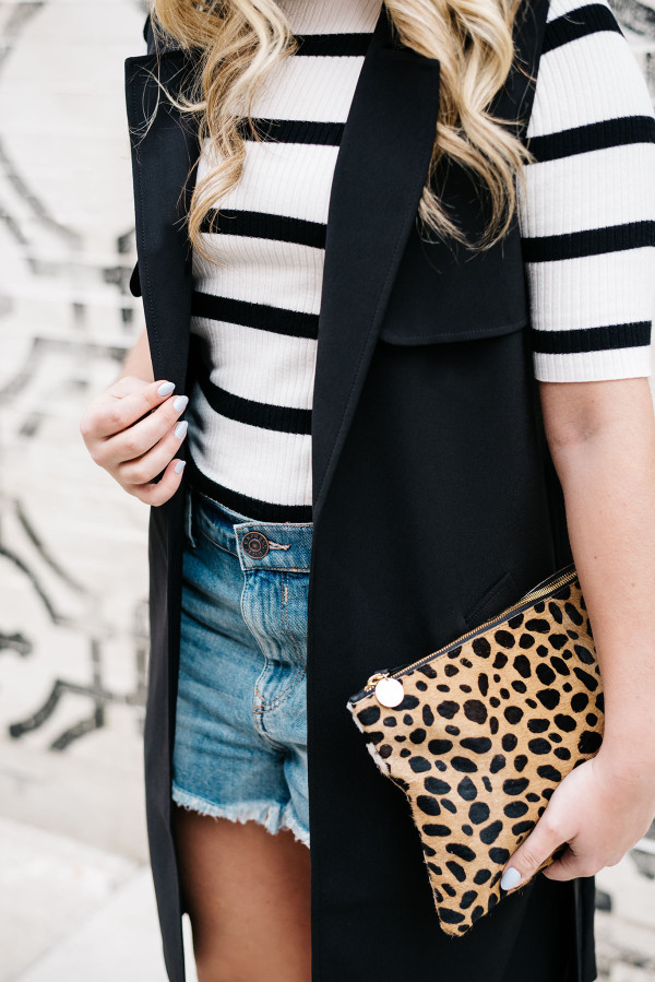 print mixing stripes and leopard print with jean shorts and a black vest