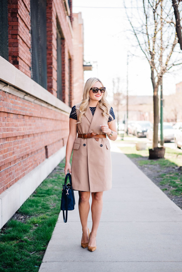 spring work outfit with a vest over a dress