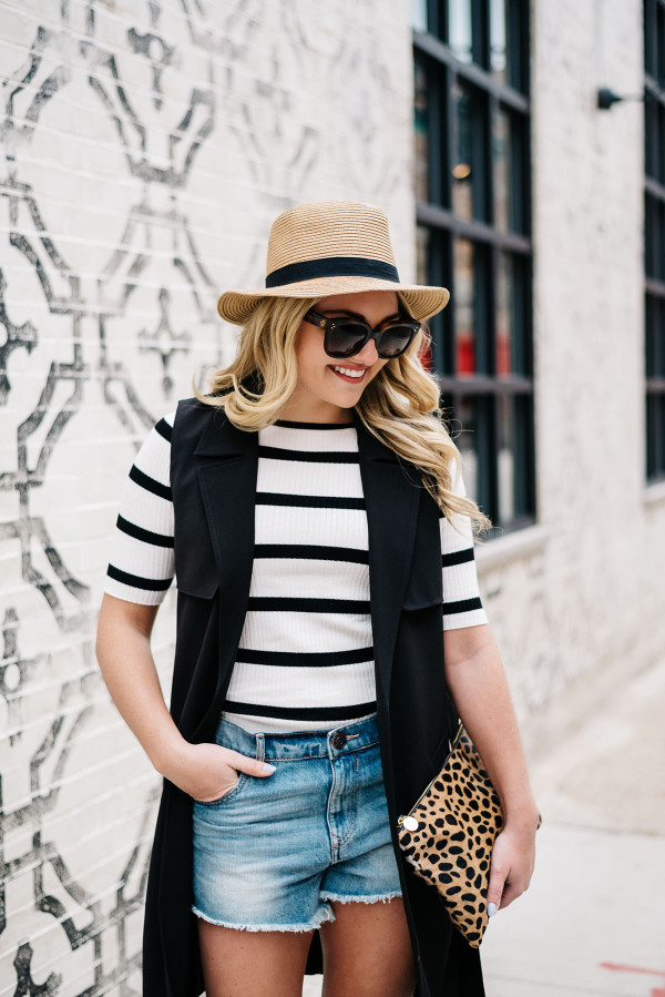 summer outfit denim shorts striped tee shirt panama hat leopard clutch black vest