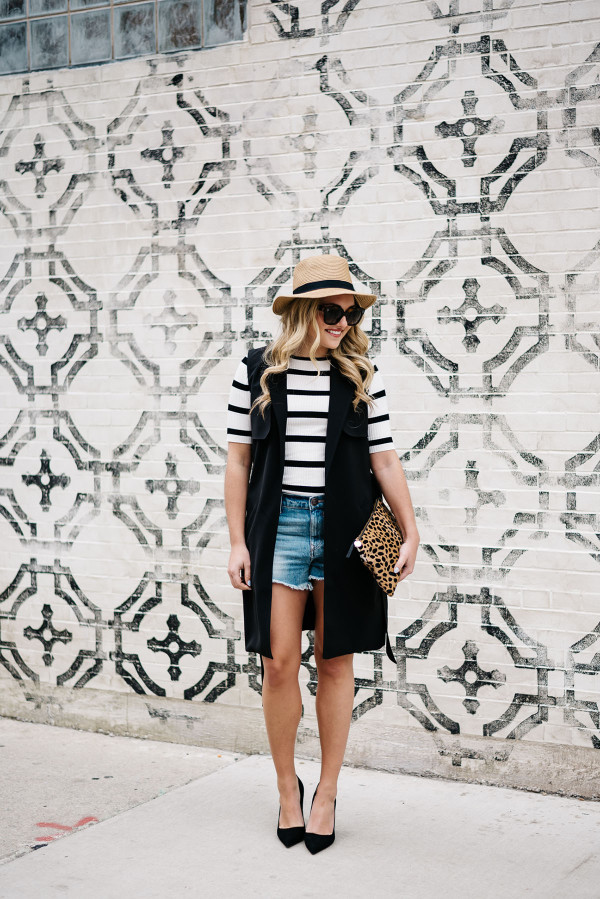 summer outfit with high waisted denim shorts striped tee shirt long black vest
