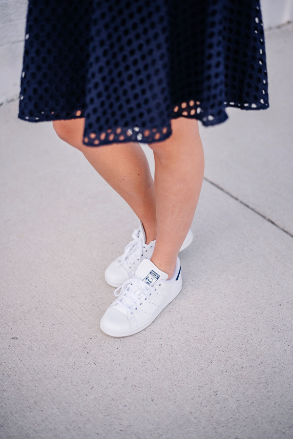 wearing a dress with adidas stan smith sneakers