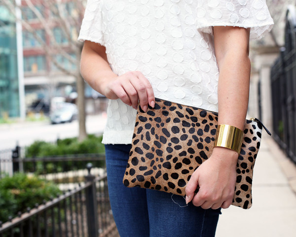 white polka dot top, leopard clutch, gold cuff bracelet