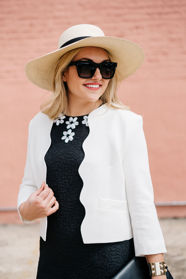 white scalloped blazer, black draper james dress with white flowers, valentino sunglasses