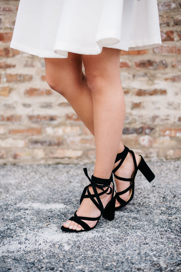 white skirt dress with black high heel sandals
