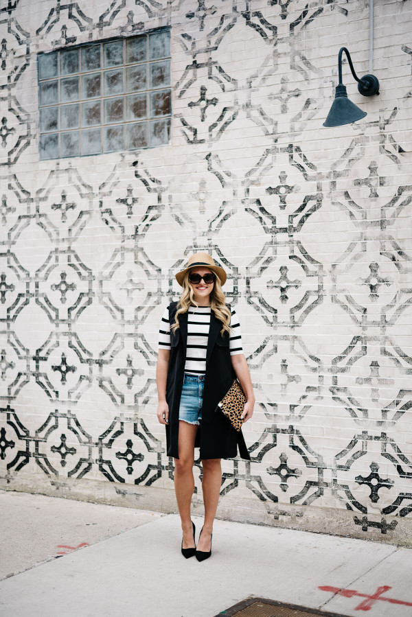 womens jean shorts outfit with heels and a hat