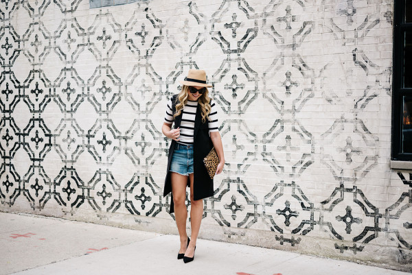 womens outfit short denim shorts with high heels and a long vest
