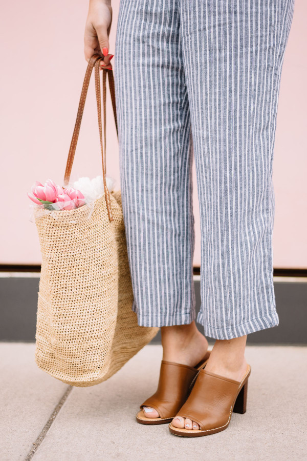 blue and white striped pants, leather mules, straw tote, tulips