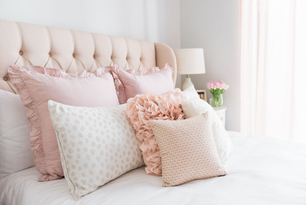 Blogger Jessica Sturdy of Bows & Sequins shares her Chicago Parisian-chic bedroom design. Tufted linen headboard, ruffled Crane & Canopy bedding, Ballard Designs spotted beige animal print shams.