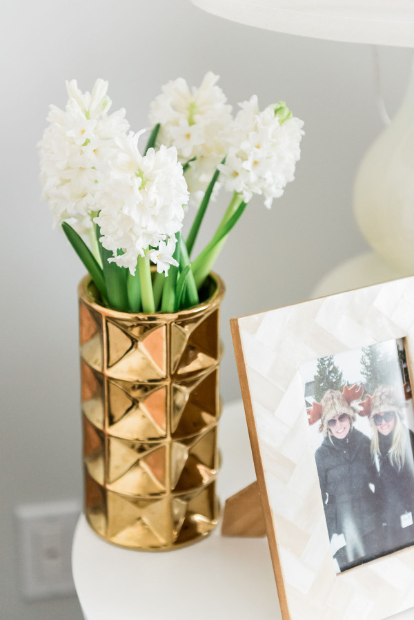 Blogger Jessica Sturdy of @bowsandsequins shares her Chicago Parisian-chic bedroom design. // White Hyacinth, Gold Vase.