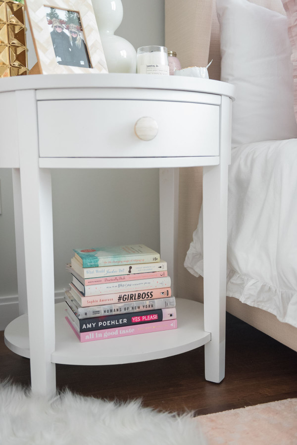Blogger Jessica Sturdy of @bowsandsequins shares her Chicago Parisian-chic bedroom design. // Pink Coffee Table Books, White Ruffled Bedding