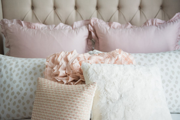 Blogger Jessica Sturdy of Bows & Sequins shares her Chicago Parisian-chic bedroom design. Tufted linen headboard, ruffled Crane & Canopy bedding, Ballard Designs spotted beige animal print shams, Pier 1 throw pillows.