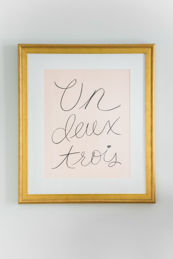 Blogger Jessica Sturdy of @bowsandsequins shares her Chicago Parisian-chic bedroom design. // Rifle Paper Un Deux Trois Blush Pink Print, Antique Gold Frame from SimplyFramed