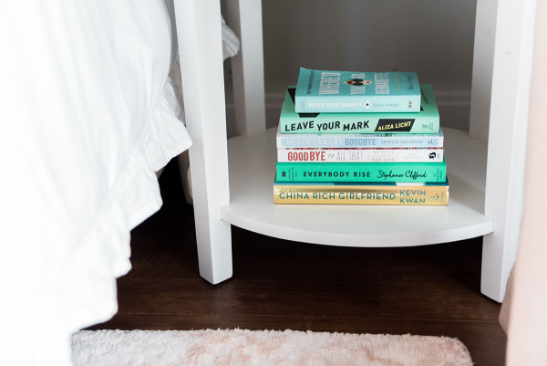Blogger Jessica Sturdy of @bowsandsequins shares her Chicago Parisian-chic bedroom design. // Blue Coffee Table Books