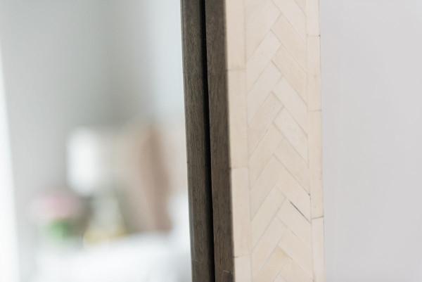 Blogger Jessica Sturdy of @bowsandsequins shares her Chicago Parisian-chic bedroom design. // West Elm Bone Inlay Floor Mirror