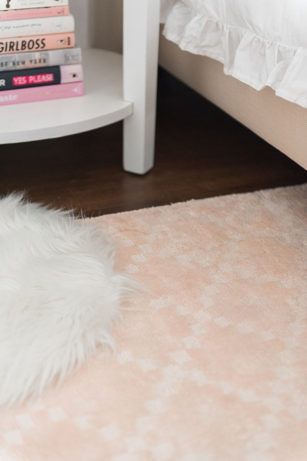 Blogger Jessica Sturdy of @bowsandsequins shares her Chicago Parisian-chic bedroom design. // Pier 1 Blush Pink Rug, Lulu & Georgia White Shag Rug, Pink Coffee Table Books
