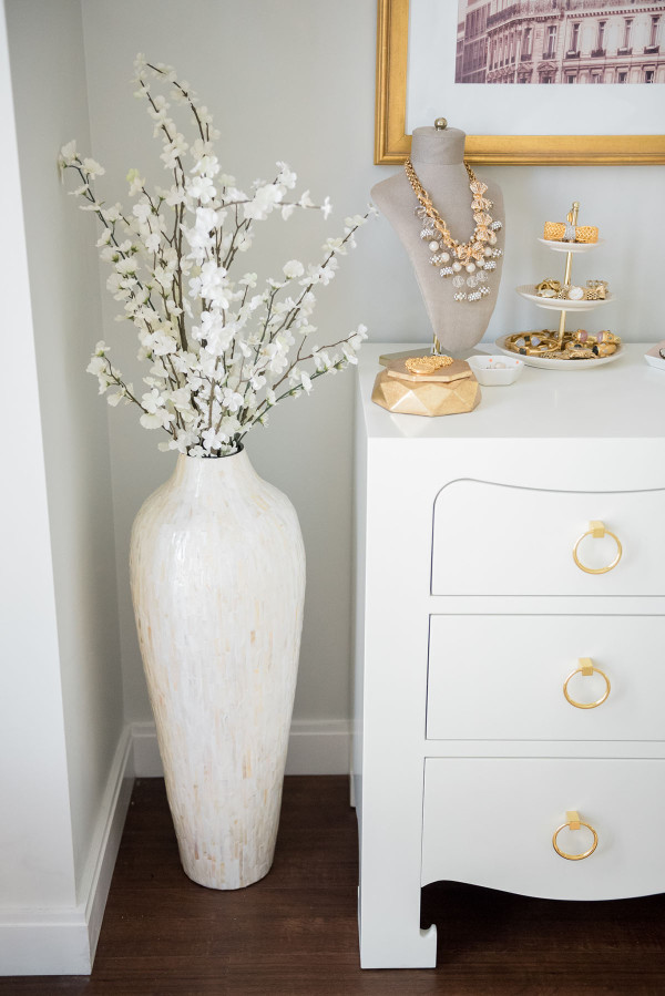 Blogger Jessica Sturdy of @bowsandsequins shares her Chicago Parisian-chic bedroom design. // Glass Pearly Mosaic Floor Vase, Bungalow 5 White Jacqui Dresser with Gold Drawer Pulls